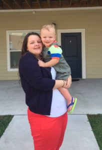 Cassondra Smith stands with her young son outside of her apartment at the Scholar House in Pikeville. Smith participated in Big Sandy Area Community Action Program's In-School Youth Program and was a recent recipient of the Community Services Block Grant Scholarship.
