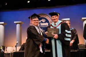 Greg Castle of Staffordsville, left, shakes hands with Dr. Devin Stephenson of Big Sandy Community and Technical College upon receiving his electrical degree. Castle graduated in May with the help of the Hiring Our Miners Everyday program after being laid off from the coal industry.