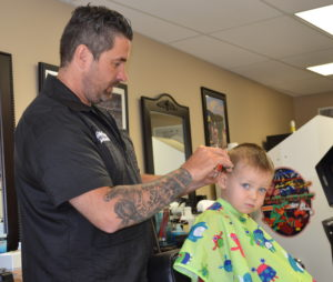 Michael Lowe was laid off from his work as a coal miner but is now working as a barber at Goodfellas Barbershop on Division Street in Pikeville after taking advantage of the educational opportunities provided by the Hiring Our Miners Everyday Program and Big Sandy Area Community Action Program.
