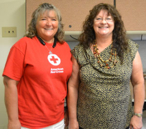 Jane E. Holycross, the leader of the Eastern Kentucky Red Cross' Pillowcase Project, stands with Big Sandy Area Community Action Program Resource Representative Wendy Bolen at the BSACAP service office in Allen. Holycross shared information on Red Cross recommendations for disaster preparedness.